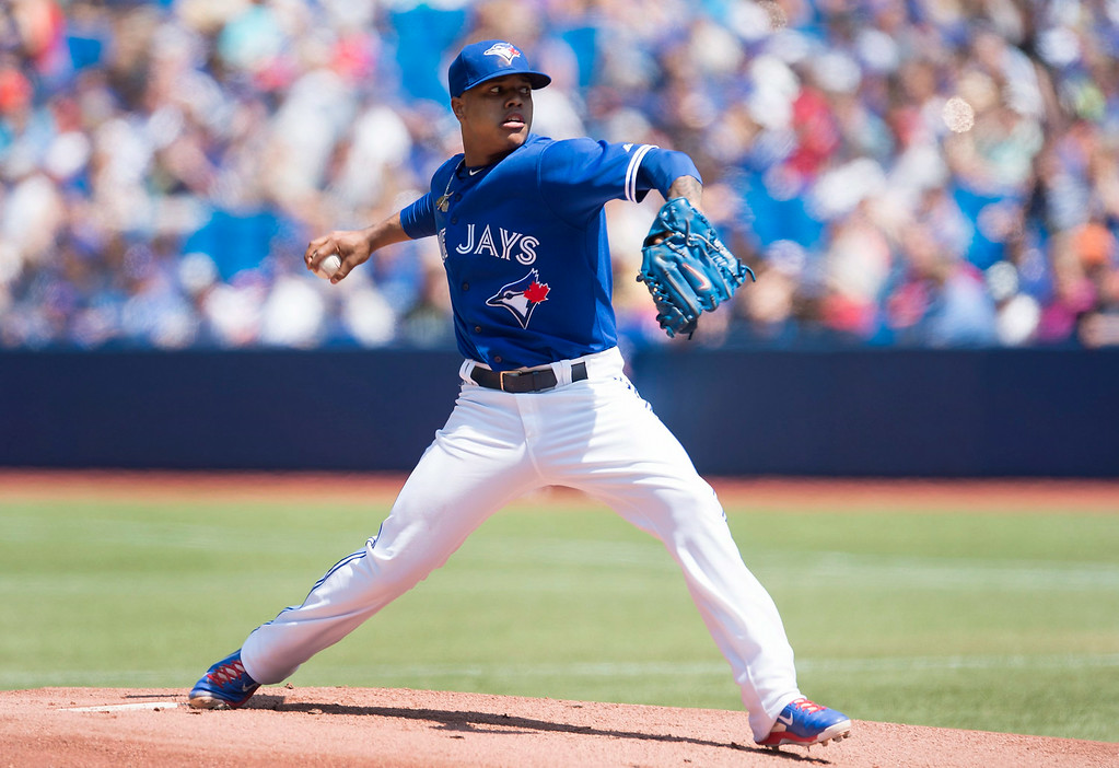 . Toronto Blue Jays starting pitcher Marcus Stroman works against the Detroit Tigers during the first inning of a baseball game in Toronto on Saturday, Aug. 9, 2014. (AP Photo/The Canadian Press, Darren Calabrese)