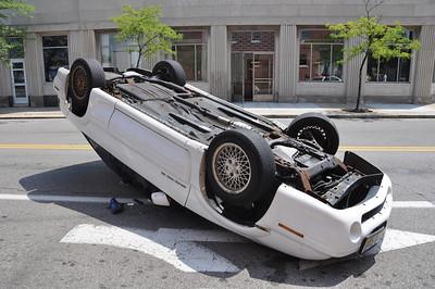 Car flips on Second Street