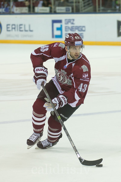 Tim Sestito (43) of Dinamo Riga controls the puck