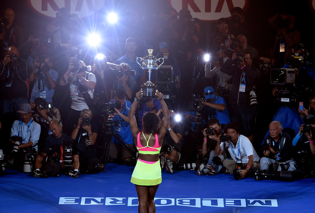 . Serena Williams of the U.S. holds the trophy in front of photographers, after defeating Maria Sharapova of Russia in the women\'s singles final at the Australian Open tennis championship in Melbourne, Australia, Saturday, Jan. 31, 2015. (AP Photo/Andy Brownbill)