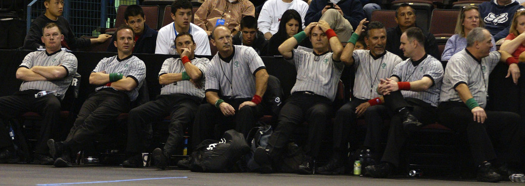 . Officials relax between matches during the California Interscholastic Federation wrestling championships in Bakersfield, Calif., on Saturday, March 2, 2013. (Anda Chu/Staff)