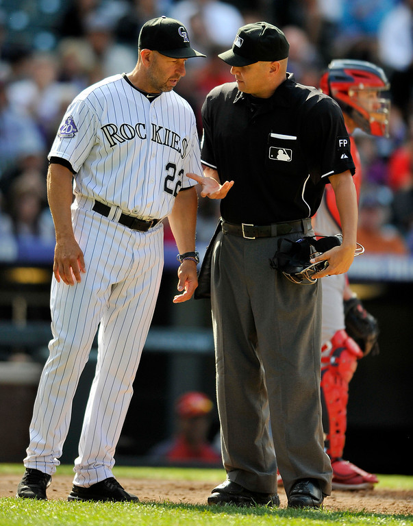 . Colorado Rockies manager Walt Weiss, left, argues a call with home plate umpire Vic Carapazza during the sixth inning of a baseball game against the St. Louis Cardinals, Thursday, Sept. 19, 2013, in Denver. (AP Photo/Jack Dempsey)
