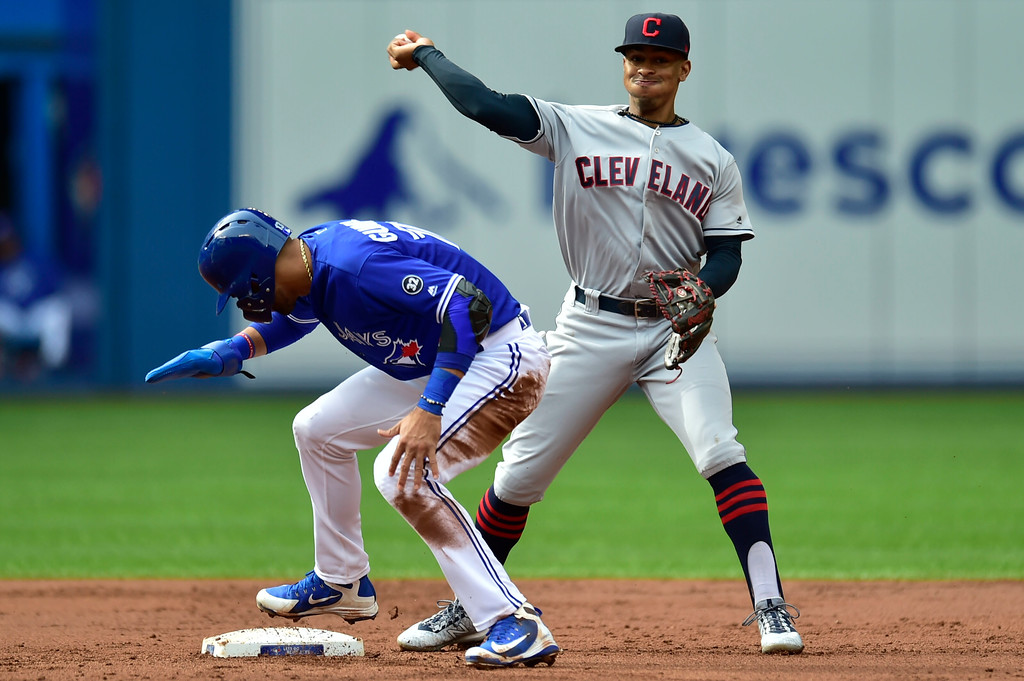 . Cleveland Indians shortstop Francisco Lindor (12) throws to first base after forcing out Toronto Blue Jays Lourdes Gurriel Jr. at second base during the first inning of a baseball game in Toronto, Saturday, Sept .8, 2018. (Frank Gunn/The Canadian Press via AP)