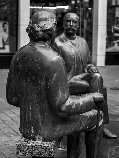 Bronze sculpture of the Irish writer Oscar Wilde (left) and the Estonian writer Eduard Vilde (right), Galway City, County Galway, Republic of Ireland