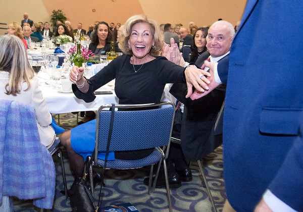 11/21/19 Wesley Bunnell | StaffrrThe Greater New Britain Chamber of Commerce celebrated their 106th year with their annual dinner on Friday night at CCSU. Karen Sagarino congratulates an award winner as she sits next to husband Donald Sagarino, R.