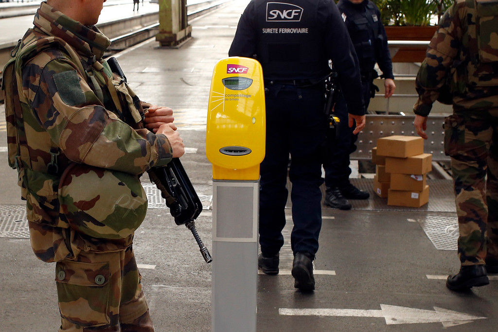 . French soldiers check unattended boxes left on the platform at Gare De Lyon railway station in Paris, France, Tuesday, March 22, 2016. Authorities are tightening security at airports and on the streets of European cities after attacks on the Brussels airport and subways system that killed at least one person and injured many others. (AP Photo/Francois Mori)