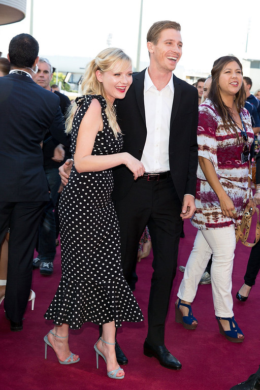 ". Kirsten Dunst and Garrett Hedlund arrive at the ""Anchorman 2: The Legend Continues\"" Australian premiere on November 24, 2013 in Sydney, Australia.  (Photo by Caroline McCredie/Getty Images for Paramount Pictures International)"
