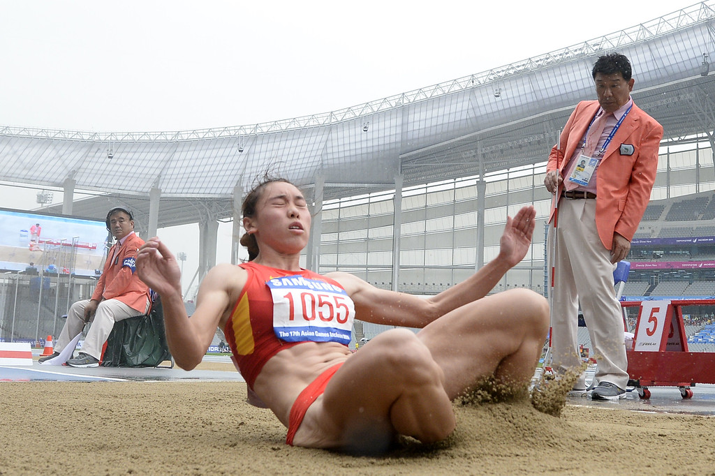 . China\'s Wang Qingling competes in the women\'s heptathlon long jump athletics event during the 17th Asian Games at the Incheon Asiad Main Stadium in Incheon on September 29, 2014. MARTIN BUREAU/AFP/Getty Images