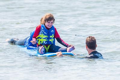 Maggie Surfing at Skudin Surf Camp 7-30-21