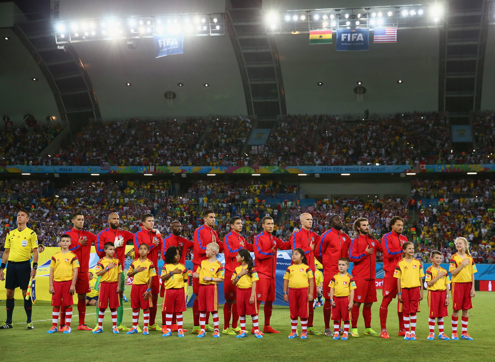 Description of . Players of the United States line up on the field before the 2014 FIFA World Cup Brazil Group G match between Ghana and the United States at Estadio das Dunas on June 16, 2014 in Natal, Brazil.  (Photo by Kevin C. Cox/Getty Images)