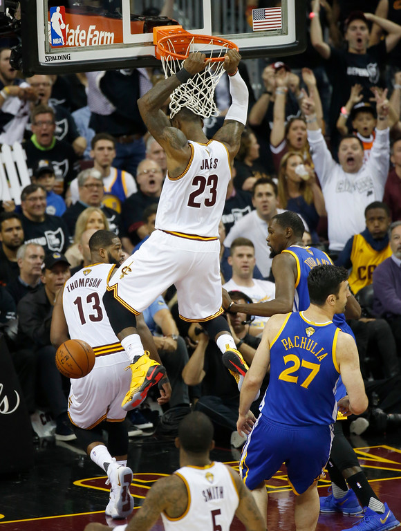 . Cleveland Cavaliers forward LeBron James dunks against the Golden State Warriors in the second half of Game 4 of the NBA Finals in Cleveland on June 9. The Cavaliers won, 137-116, but still trailed in the series, 1-3. James led the Cavs in assists (11) and rebounds (10), and Kyrie Irving led in points (40). (AP Photo/Ron Schwane)