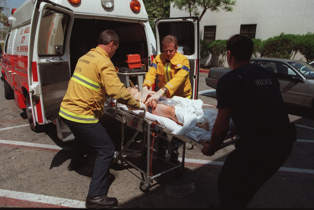 . A male victim is delivered to Holy Cross Hospital in Granada Hills by paramedics.  Five victims, three male children and two female adults, were shot at the North Valley Jewish Community Center in Granada Hills, California Tuesday morning, August 10, 1999.   Los Angeles Daily News file photo.