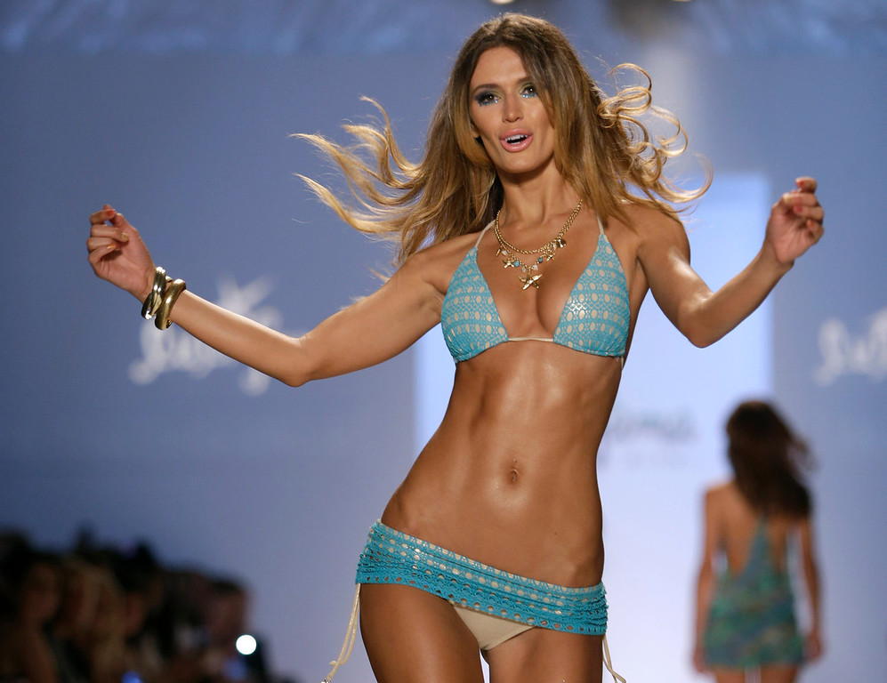 . A model walks the runway during the Luli Fama show at Mercedes-Benz Fashion Week Swim, Sunday, July 21, 2013, in Miami Beach, Fla. (AP Photo/Lynne Sladky)