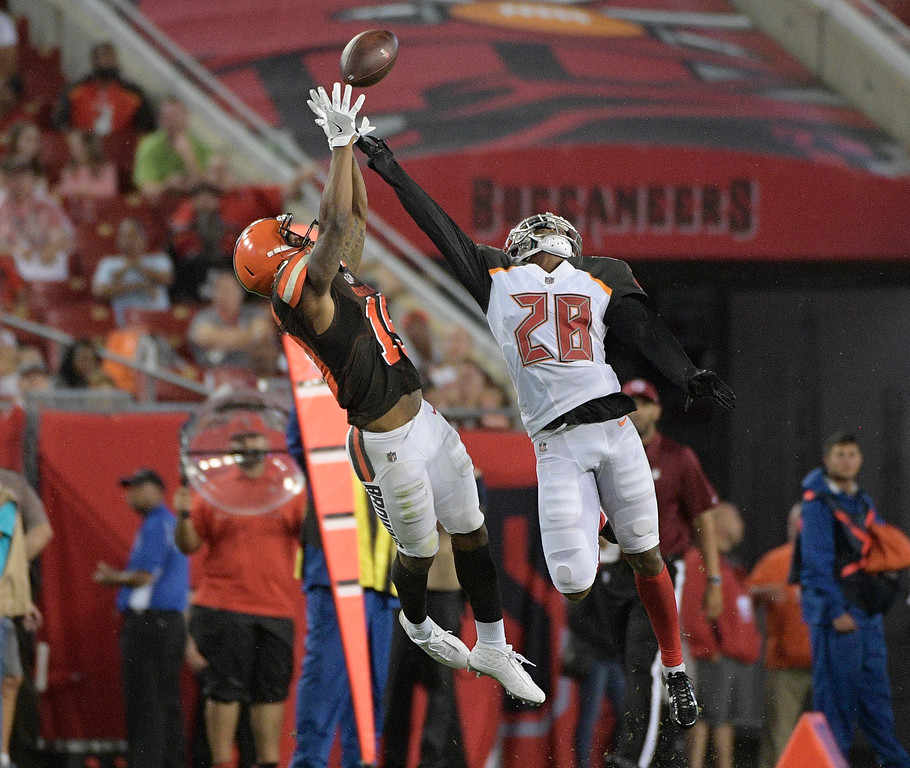 . Tampa Bay Buccaneers cornerback Vernon Hargreaves (28) tips the ball away from Cleveland Browns wide receiver Corey Coleman during the third quarter of an NFL preseason football game Saturday, Aug. 26, 2017, in Tampa, Fla. (AP Photo/Phelan Ebenhack)