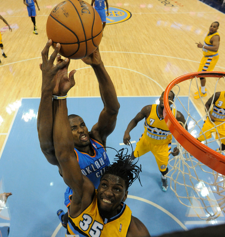 . Denver Nuggets power forward Kenneth Faried (35) battles for a rebound with Oklahoma City Thunder power forward Serge Ibaka (9) during the fourth quarter December 17, 2013 at Pepsi Center. (Photo by John Leyba/The Denver Post)