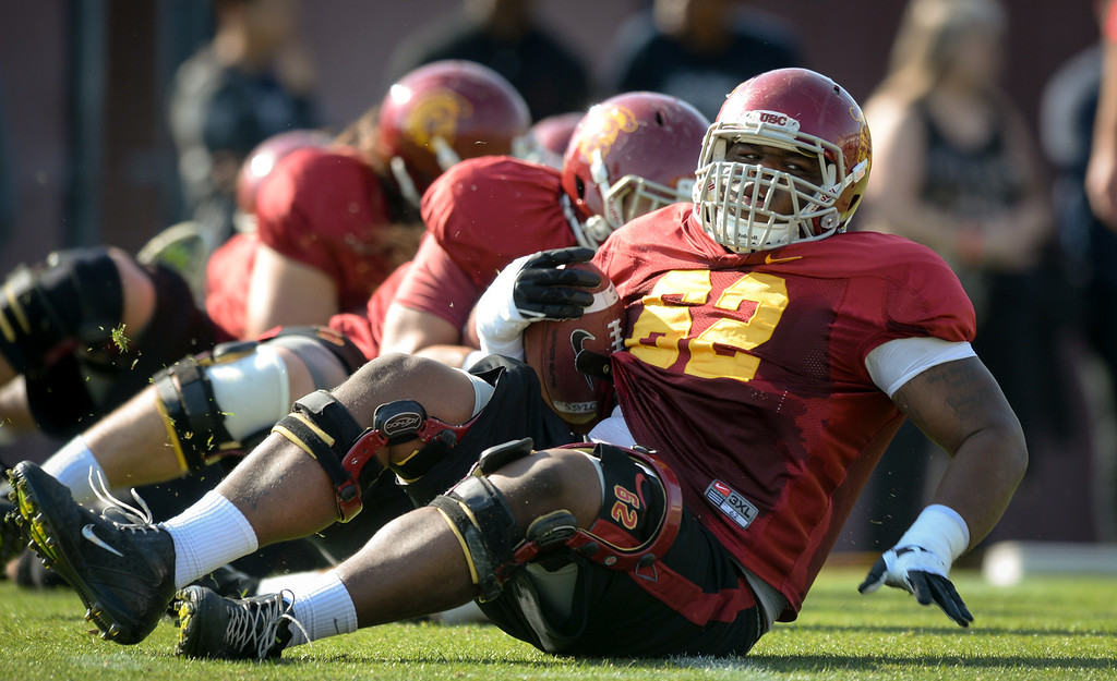 . USC OL Khaliel Rodgers (#62) practices a fumble recovery drill, Thursday, March 27, 2014, at USC. (Photo by Michael Owen Baker/L.A. Daily News)
