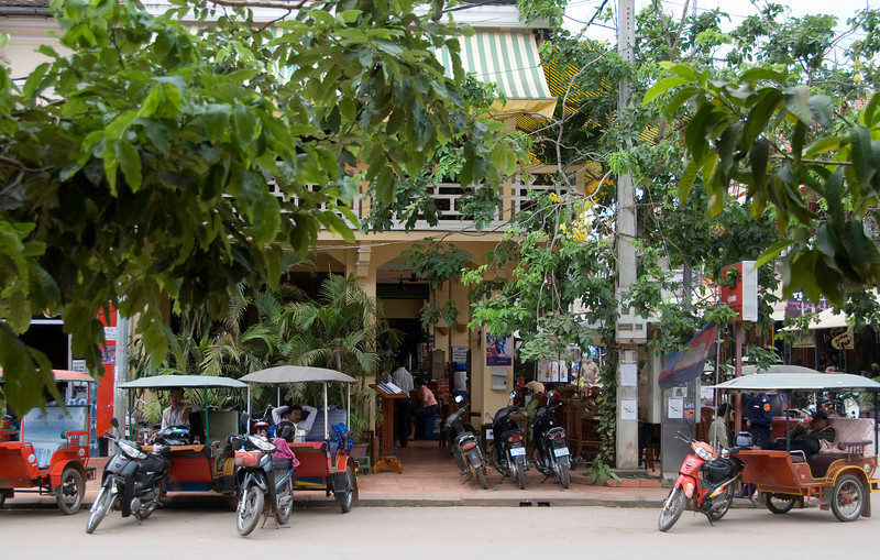 Outside the Soup Dragon, Siem Reap.  There was an Obama sign on the post to the right of the motorbikes.