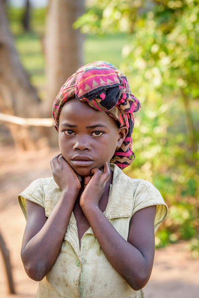 Neighbor girl andfriend of Marie. Miscellaneous children and adults in Tubuluku, Kananga, Kasai Central Province, DRC, where World Vision is providing relief aid and has multiple Child Friendly Space facilities for children.