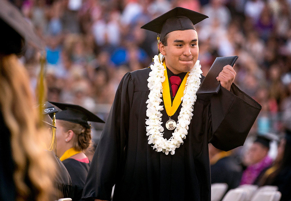 . Rafael Meza shows off his diploma to friends during Northview High graduation commencement at Covina District Field June 11, 2014.   (Staff photo by Leo Jarzomb/San Gabriel Valley Tribune)