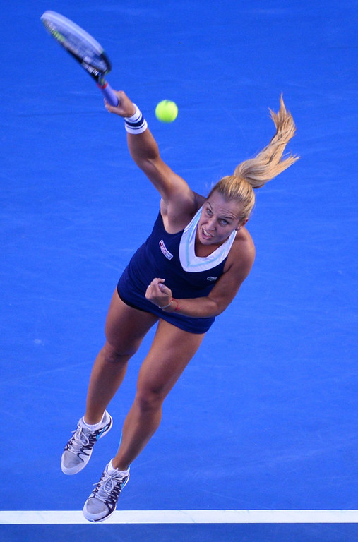 . Dominika Cibulkova of Slovakia hits a return to Li Na of China during their women\'s singles final on day 13 of the 2014 Australian Open tennis tournament in Melbourne on January 25, 2014. (WILLIAM WEST/AFP/Getty Images)