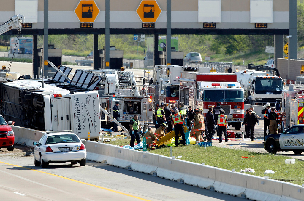 . First responders are on the scene of a Cardinal Coach Line charter bus accident on Hwy. 161 in Irving, Texas on Thursday morning, April 11, 2013. (AP Photo/The Dallas Morning News, Tom Fox)