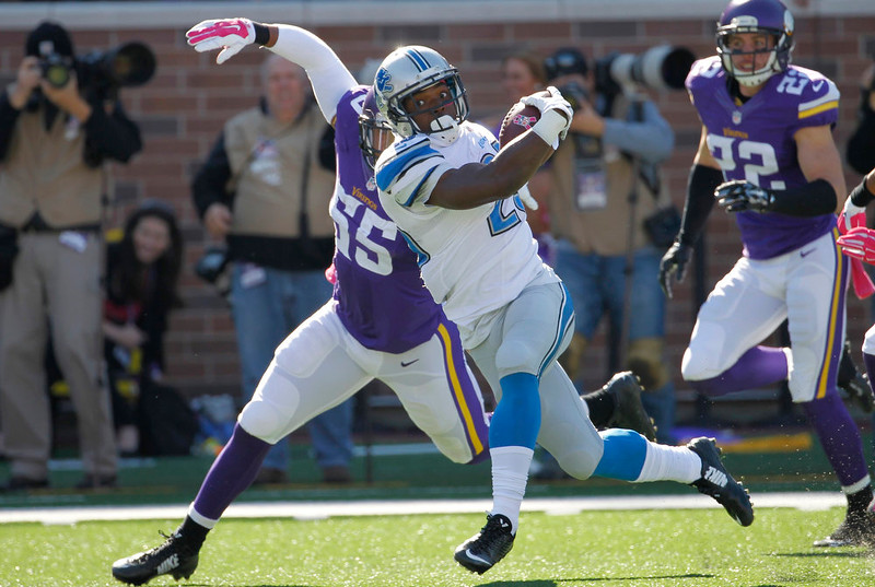 . Detroit Lions running back Theo Riddick (25) is brought down by Minnesota Vikings outside linebacker Anthony Barr (55) during the first half of an NFL football game Sunday, Oct. 12, 2014, in Minneapolis. (AP Photo/Ann Heisenfelt)