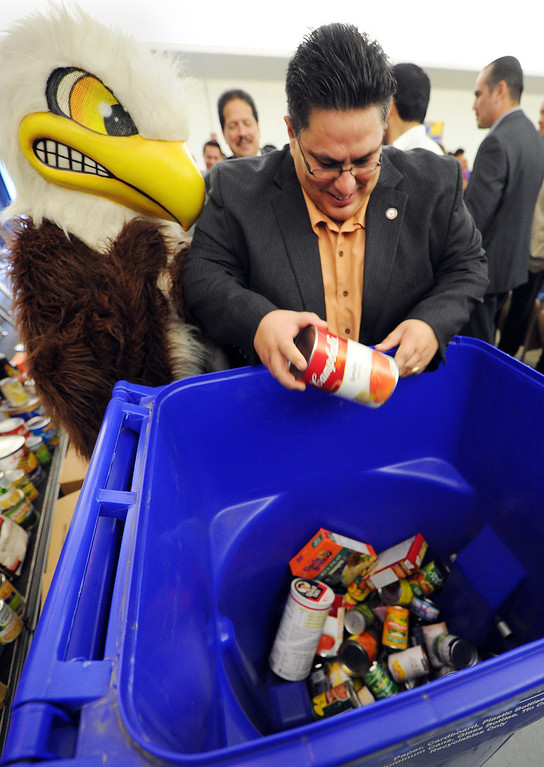 """. Board of Education President, Hector Chacon placing food in container to help start \""""War On Hunger\"""", food drive.The Montebello Unified School District and its partners bringing the community together to assist local families in need through its 5th Annual War on Hunger Food Drive.  the District\'s Kick-Off Event was held at Montebello Intermediate School Wednesday, October 16, 21013. (Photos by Walt Mancini/Pasadena Star-News)"""
