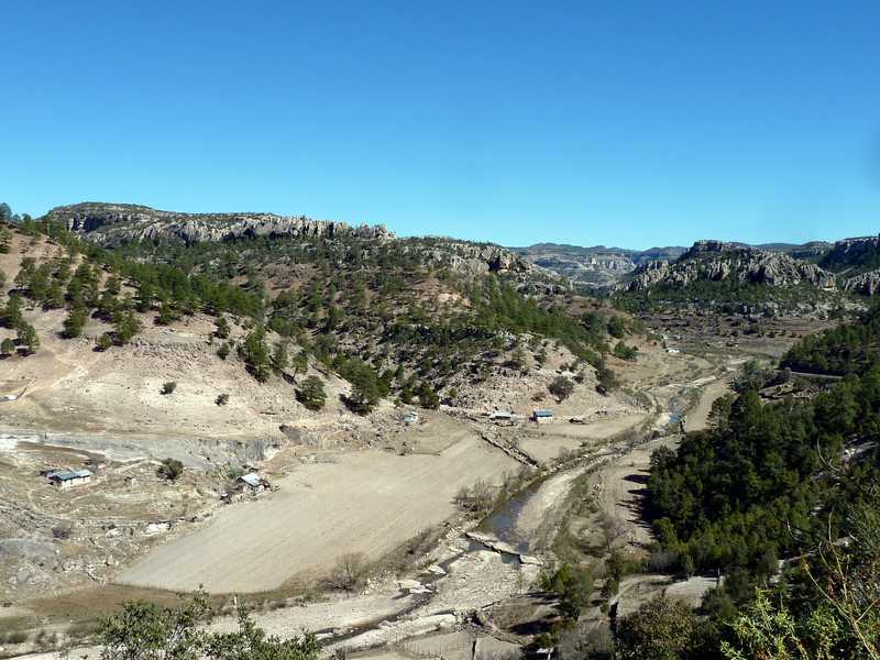 Canyons and alluvial plain. Look at the settlements for scale.