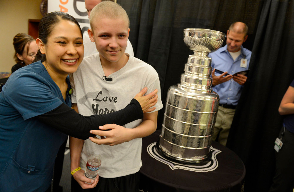 . Logan Piz, 13, gets a hug from Gaylene Alonzo, RN, while posing with the Stanley Cup at Rocky Mountain Hospital for Children in Denver, CO on May 15, 2013. The hospital, Make-A-Wish, Discover and the National Hockey League teamed up to grant Logan\'s wish to spend a day with the Stanley Cup and share it with friends, family and supporters. Logan has not played hockey since he was diagnosed with Ewing�s sarcoma in November 2012. (Photo By Craig F. Walker/The Denver Post)