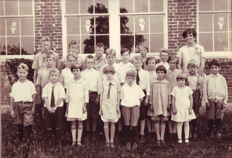 School House #4 This image is circa 1927. Located on the corner of Parmenter Road and High Range Road, the school house was built in 1850. Grades 1 through eight attended the school, which is now a private residence. Pictured include: Roy Holton (back row, far left); Ed Misiaszek (back row, second from left); Loiuse Holton (back row, third from right); Miss Call (teacher, back row, far right); Fred Misiaszek (second row, far left); Quinton Elwood (second row, fifth from right); Patsy (boarder, second row, far right); John Ralston (front row, second from left); Amy Elwood (front row, center); and Rae Parmenter (front row, far right).