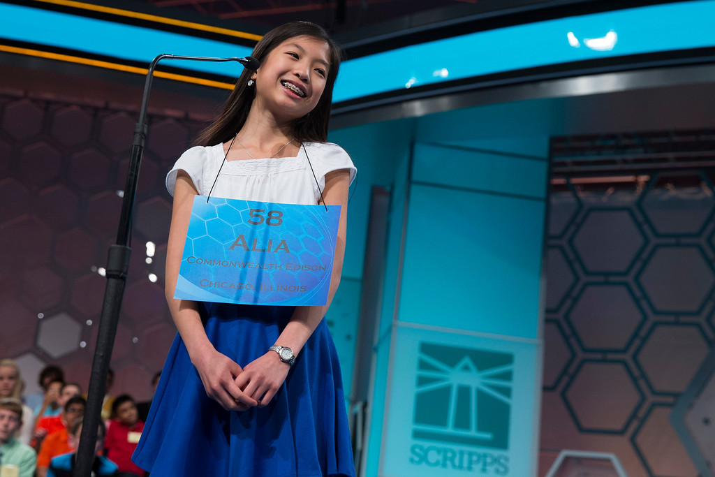 ". Alia Abiad, 14, of Western Springs, Ill., smiles after spelling the word ""collyrium\"" correctly during the final round of the National Spelling Bee, on Thursday, May 29, 2014, in Oxon Hill, Md. (AP Photo/ Evan Vucci)"