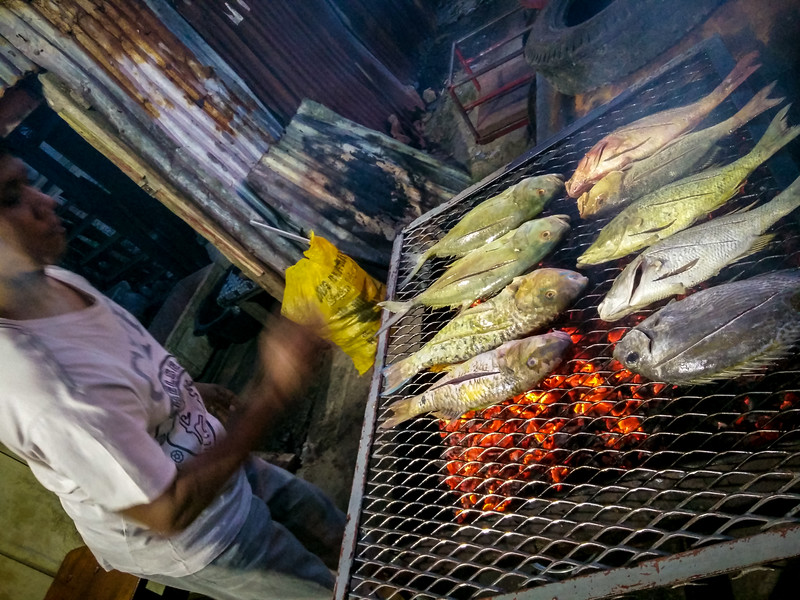 Grilling Fish at the Market