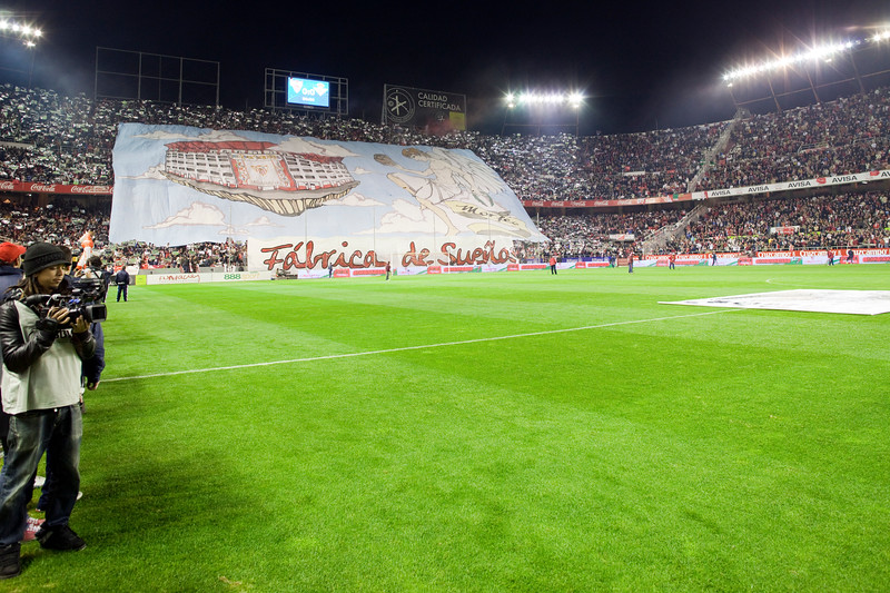 Sevilla FC fans doing a tifo. Taken before the football derby between Sevilla FC and Real Betis Balompie that took place in Sanchez Pizjuan stadium on 7 Feb 2009, Seville, Spain.