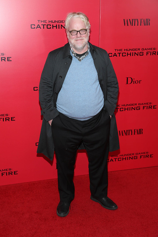 """. According to reports February 2, 2014, Philip Seymour Hoffman, 46, was found dead in his New York Cit apartment.  Phillip Seymour Hoffman attends a special screening of \""""The Hunger Games: Catching Fire\"""" on November 20, 2013 in New York City.  (Photo by Rob Kim/Getty Images)"""