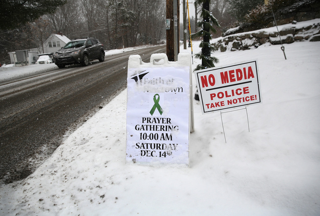 . Signs stand in front of a church near the former site of Sandy Hook Elementary on December 14, 2012 in Newtown, Connecticut. One year ago Adam Lanza shot and killed 20 first graders and six adults at the school. Newtown decided not to hold a public memorial on the anniversary out of respect for victims\' survivors, and the town appealed for privacy.  (Photo by John Moore/Getty Images)