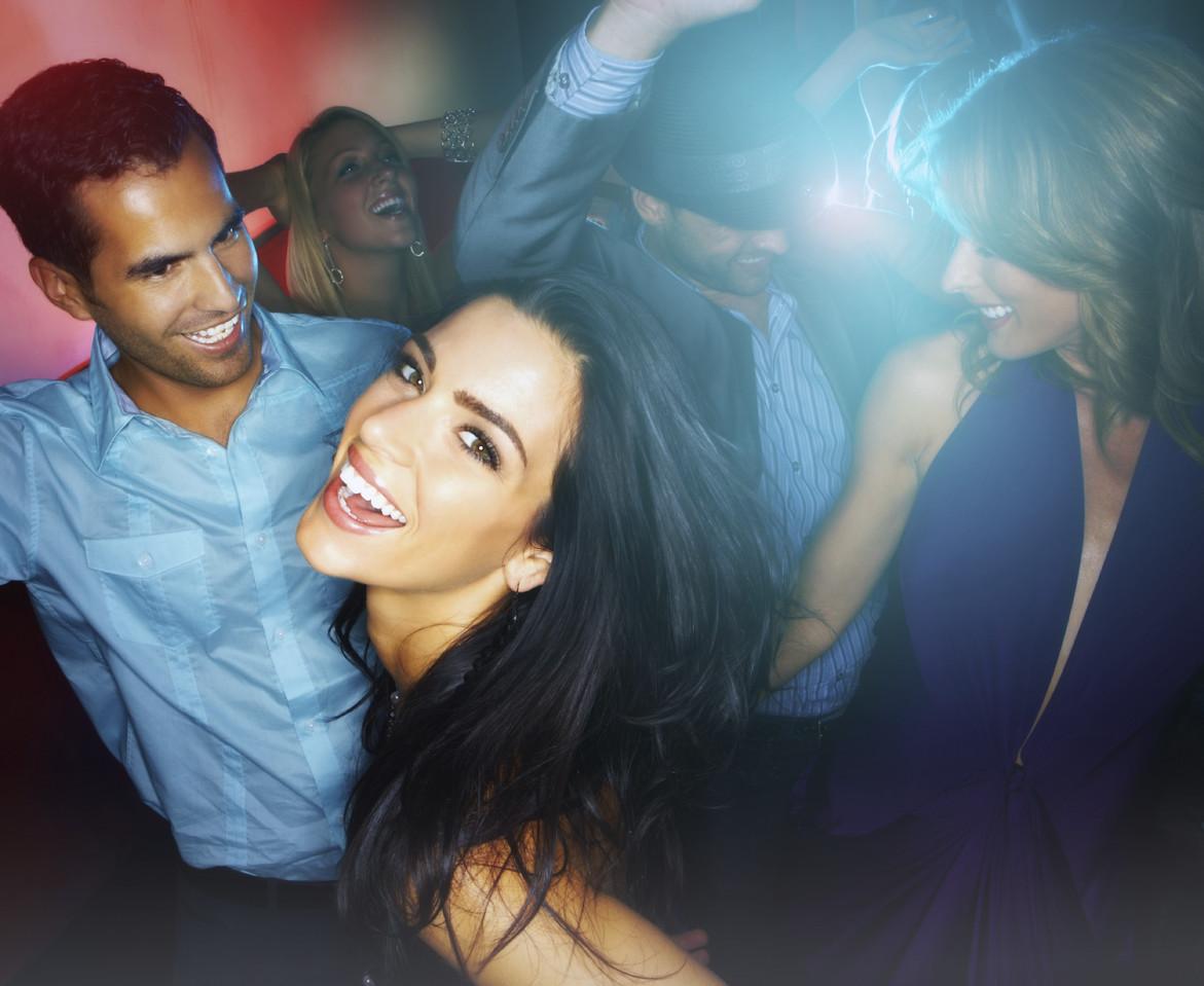 Young boys and girls enjoying at nightclub
