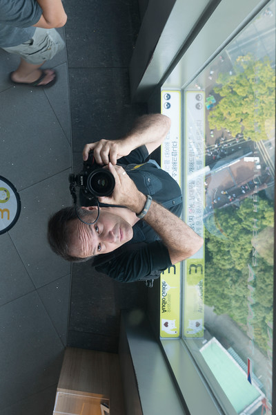 Reflection of photographer in observation tower, N Seoul Tower, Namsan Park, Namsan Mountain, Seoul, South Korea