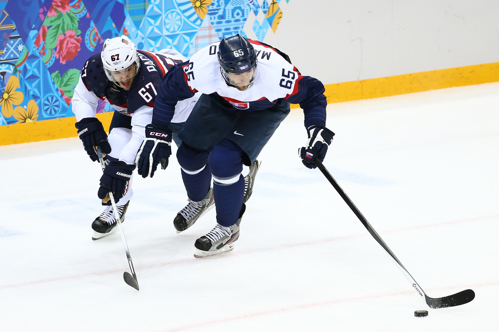 . Tomas Marcinko #65 of Slovakia (R) and Max Pacioretty #67 of United States battle for the puck during the Men\'s Ice Hockey Preliminary Round Group A game on day six of the Sochi 2014 Winter Olympics at Shayba Arena on February 13, 2014 in Sochi, Russia.  (Photo by Streeter Lecka/Getty Images)