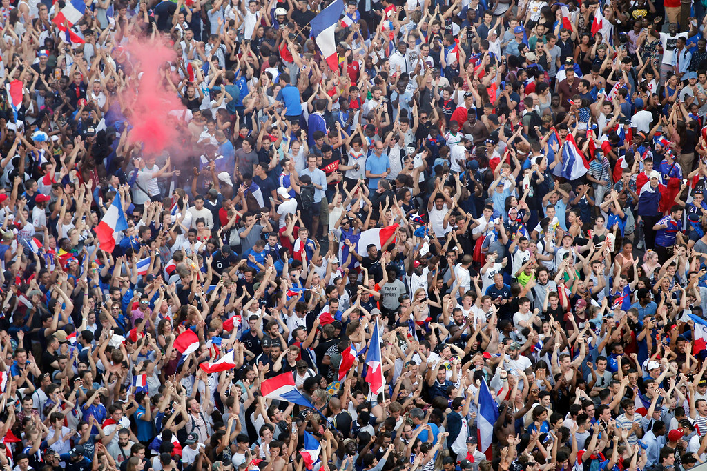 . In this picture taken from the terrace of the Publicis Group people invade the Champs Elysees avenue to celebrate France\'s World Cup victory over Croatia, in Paris, France, Sunday, July 15, 2018. France won the final 4-2. (AP Photo/Thibault Camus)