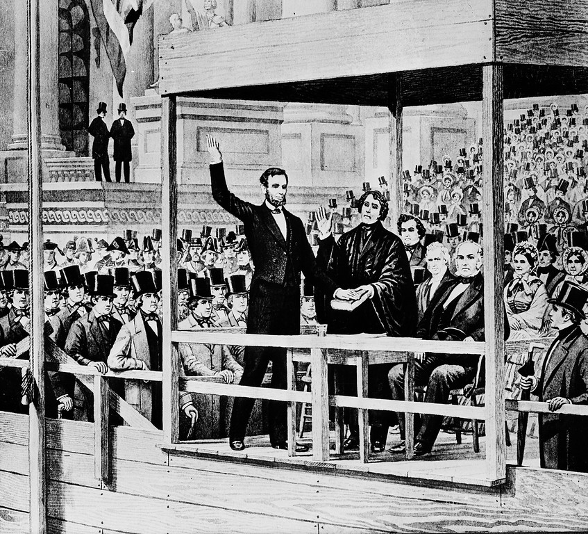 """. FILE - In this March 4, 1861 file image of a painting, Abraham Lincoln takes the oath of office as the 16th president of the United States administered by Chief Justice Roger B. Taney in front of the U.S. Capitol in Washington.  Abraham Lincoln\'s Gettysburg Address has inspired Americans for generations, but consider his jarring remarks in 1862 to a White House audience of free blacks, urging them to leave the U.S. and settle in Central America. \""""For the sake of your race, you should sacrifice something of your present comfort for the purpose of being as grand in that respect as the white people,\"""" Lincoln said, promoting his idea of colonization: resettling blacks in foreign countries on the belief that whites and blacks could not coexist in the same nation.  (AP Photo/File)"""
