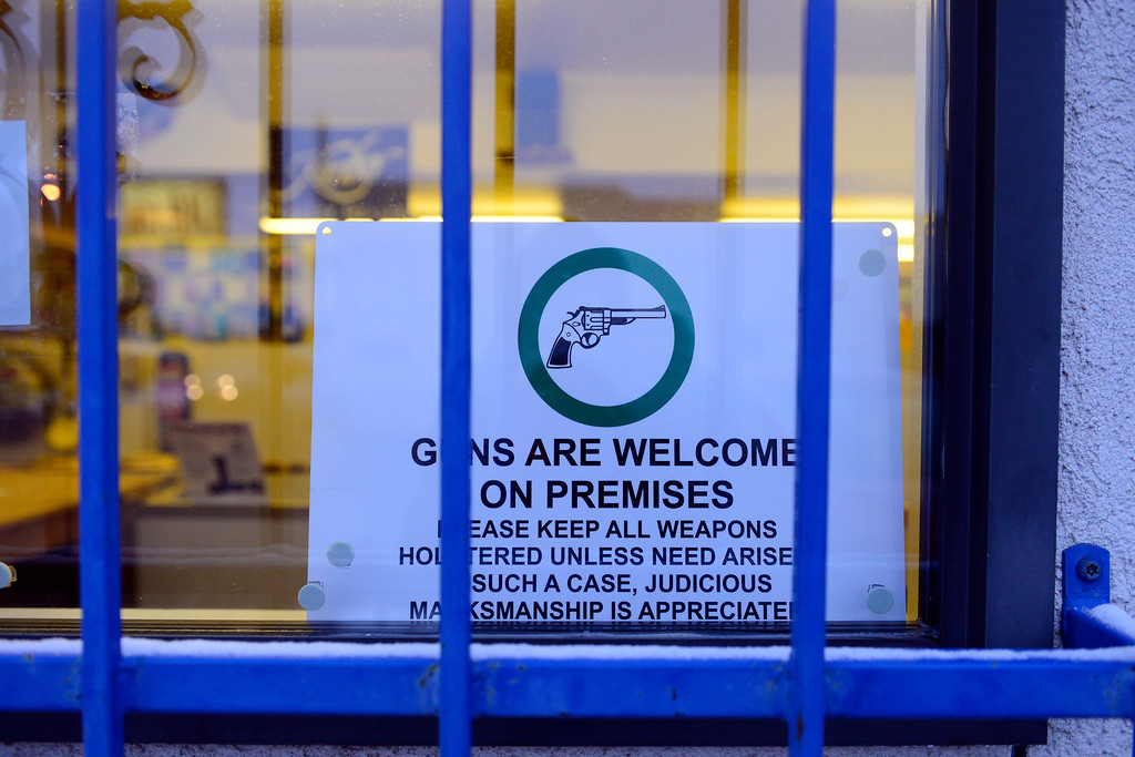 . WALSENBURG, CO - FEBRUARY 26: A sign welcoming guns outside of Hollowpoint in Walsenburg. Gun owners in southern Colorado largely agree that responsible ownership begins at home. (Photo by AAron Ontiveroz/The Denver Post)