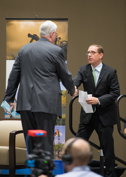 Evan Smith(right) shakes hands with Flavius Killebrew following his introduction to the stage at the Texas Tribune event. Monday September 28, 2015 at TAMU-CC.