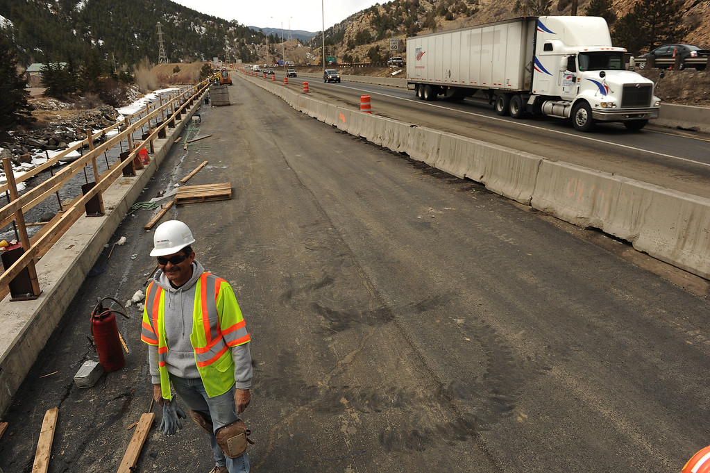 . IDAHO SPRINGS, CO- MARCH 28:  Construction worker Dan Luna checks out work along  the new lanes of the highway just west of the twin tunnels.   Construction continues on road work on I-70 and the twin tunnels near Idaho Springs on March 28th, 2013.  The highway is being widened in the east bound lanes.  The widening will start just west of the twin tunnels after Idaho Springs and will continue until the exit for Highway 6 where I-70 becomes three lanes.  They expect the project to be finished by the end of 2013.  (Photo By Helen H. Richardson/ The Denver Post)