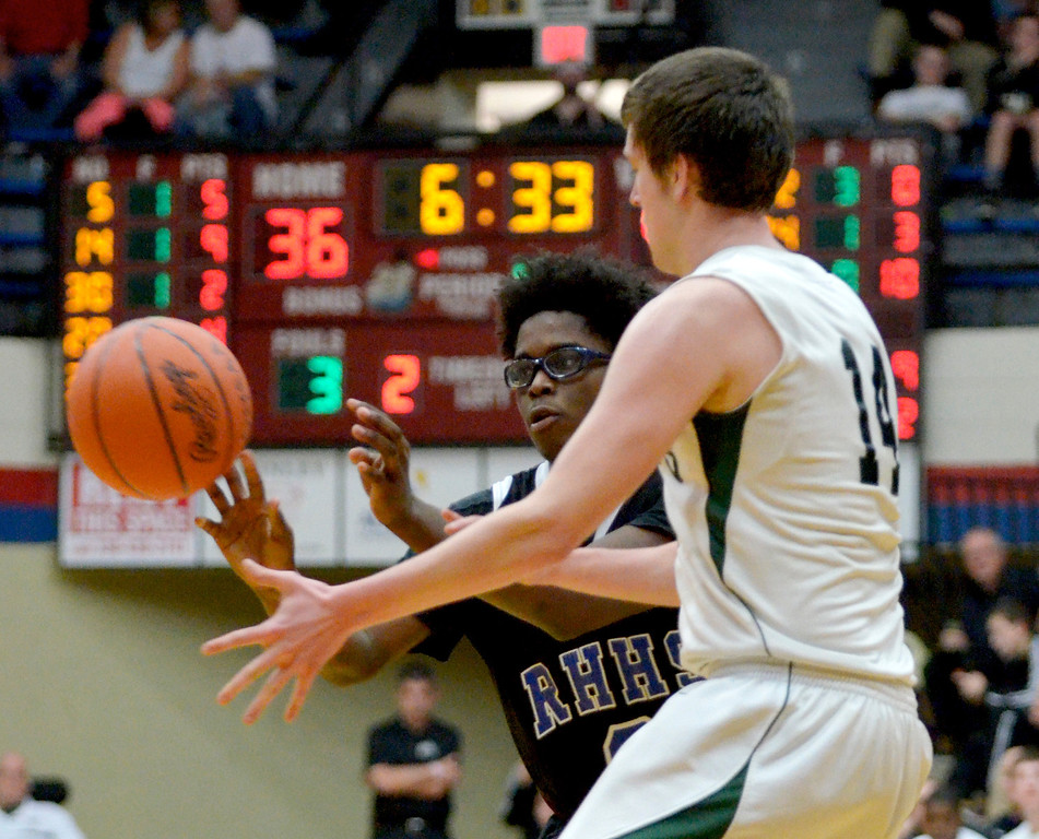 . Jeff Forman/JForman@News-Herald.com Mory Bamba passes to a teammate in the fourth quarter of the Spartans\' 59-45 Division IV regional semifinal win over Malvern March 11 at the Canton Field House.