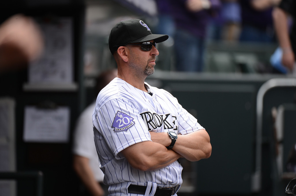 . Colorado Rockies Manager Walt Weiss waits for the start of the game in the dugout.  (Photo by Hyoung Chang/The Denver Post)