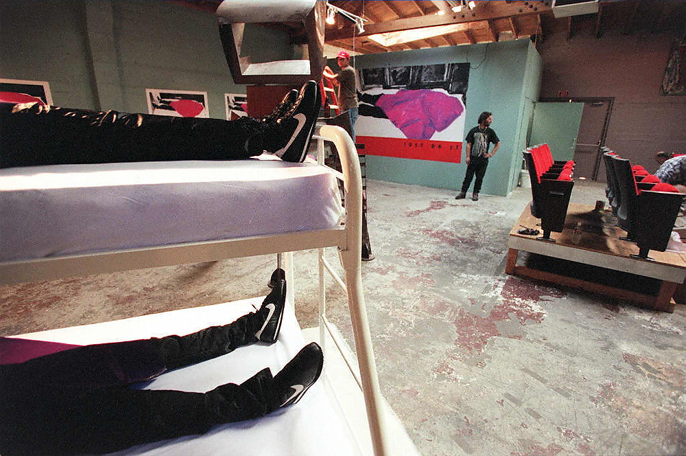 ". Artists and designers from the Art and Commerce Gallery finish the settings for the show ""Applesauce and Pudding\"" in downtown Los Angeles on April 19, 1997. The exhibit lead by artist Richard Duardo, depicts the mass suicide of 39 members of the Heaven\'s Gate cult last month near San Diego, CA. The title refers to the phenobarbital-laced apple sauce and pudding that the members ate before washing it down with alcohol to kill themselves. HECTOR MATA/AFP/Getty Images"