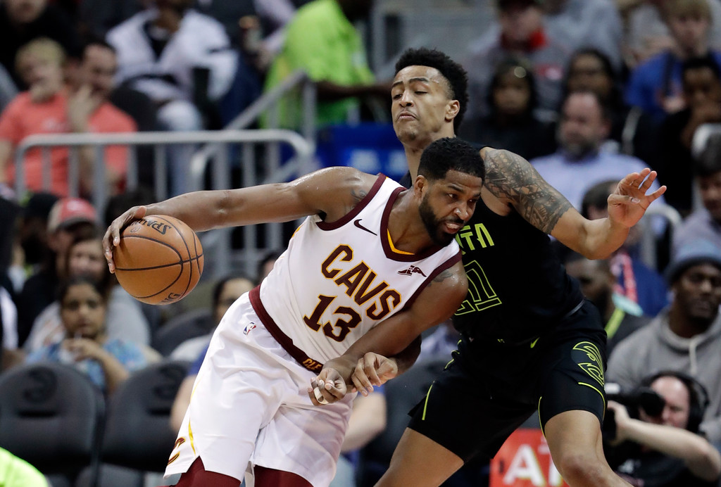 . Cleveland Cavaliers center Tristan Thompson (13) drives against Atlanta Hawks forward John Collins (20) in the first half of an NBA basketball game Friday, Feb. 9, 2018, in Atlanta. (AP Photo/John Bazemore)