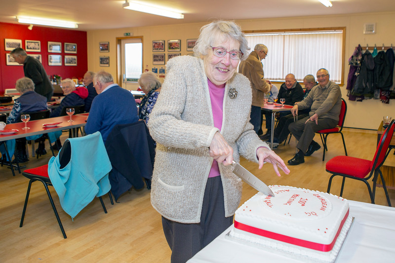 Margaret Macleod, Claypark, cuts the cake