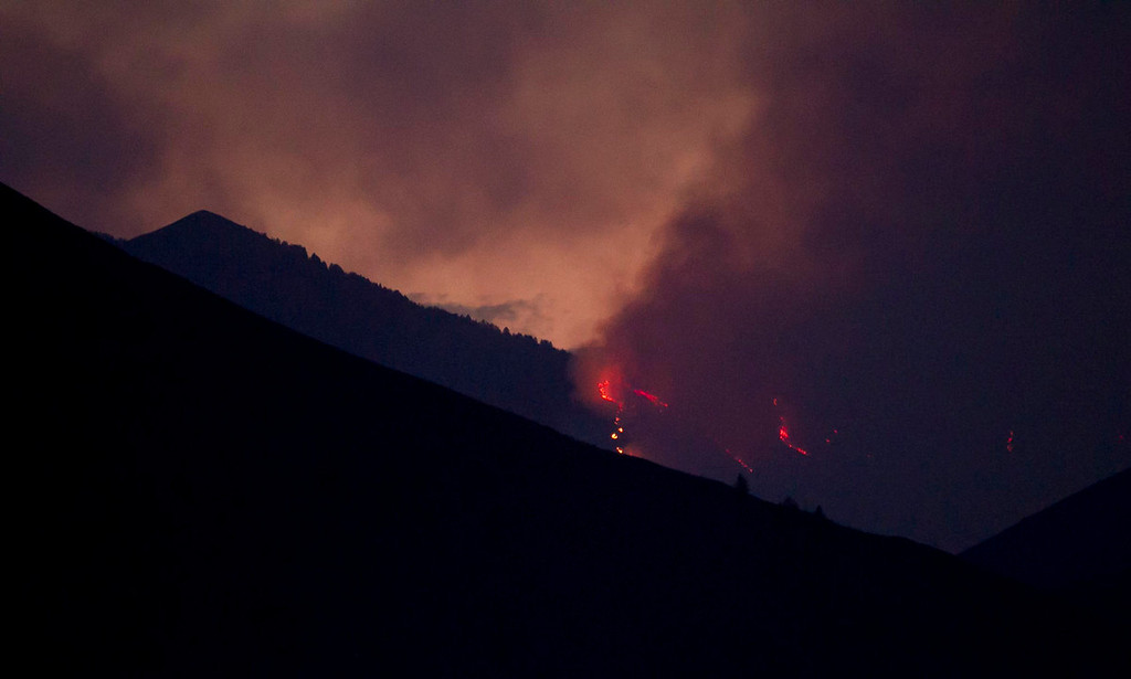 . Firefighters continue to battle the Beaver Creek Fire in the Wood River Valley of Blaine County Saturday Aug. 17, 2013. (AP Photo/Idaho Statesman, Darin Oswald)