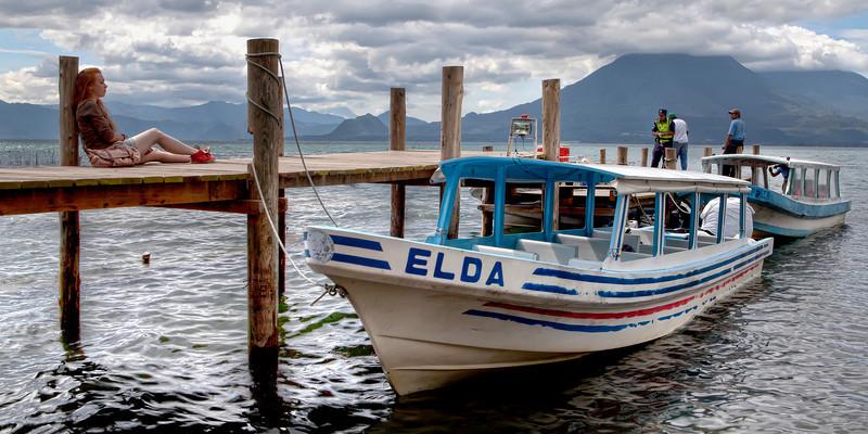 adventurous-girl-traveller-waiting-for-ferry-lake-atitlan.jpg